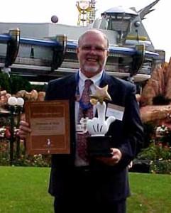 Dr. Chris Ward holding Disney Teacheriffic Award
